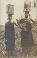 Native women carrying water.