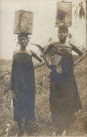 Native women carrying water.